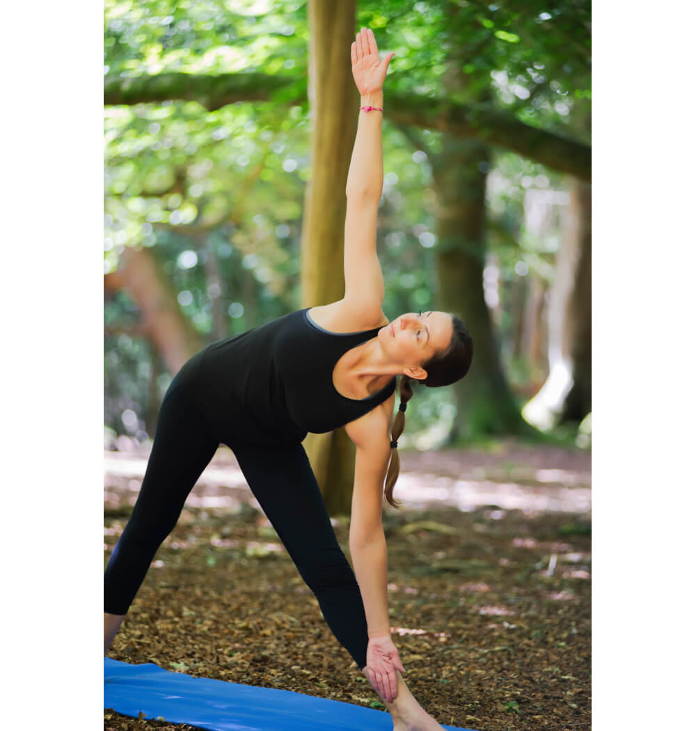 Yoga teacher Angela Keen in triangle pose