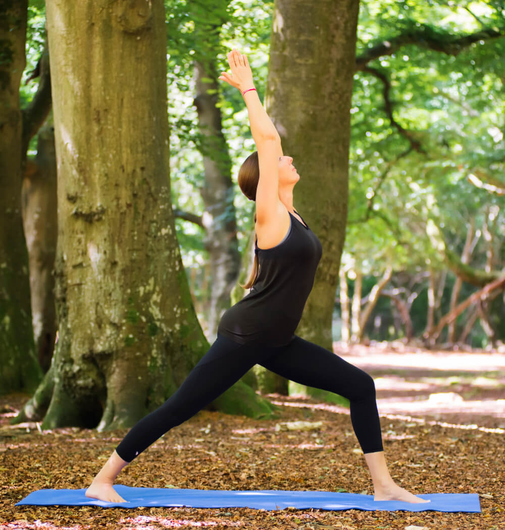 Yoga teacher Angela Keen in Warrior One pose