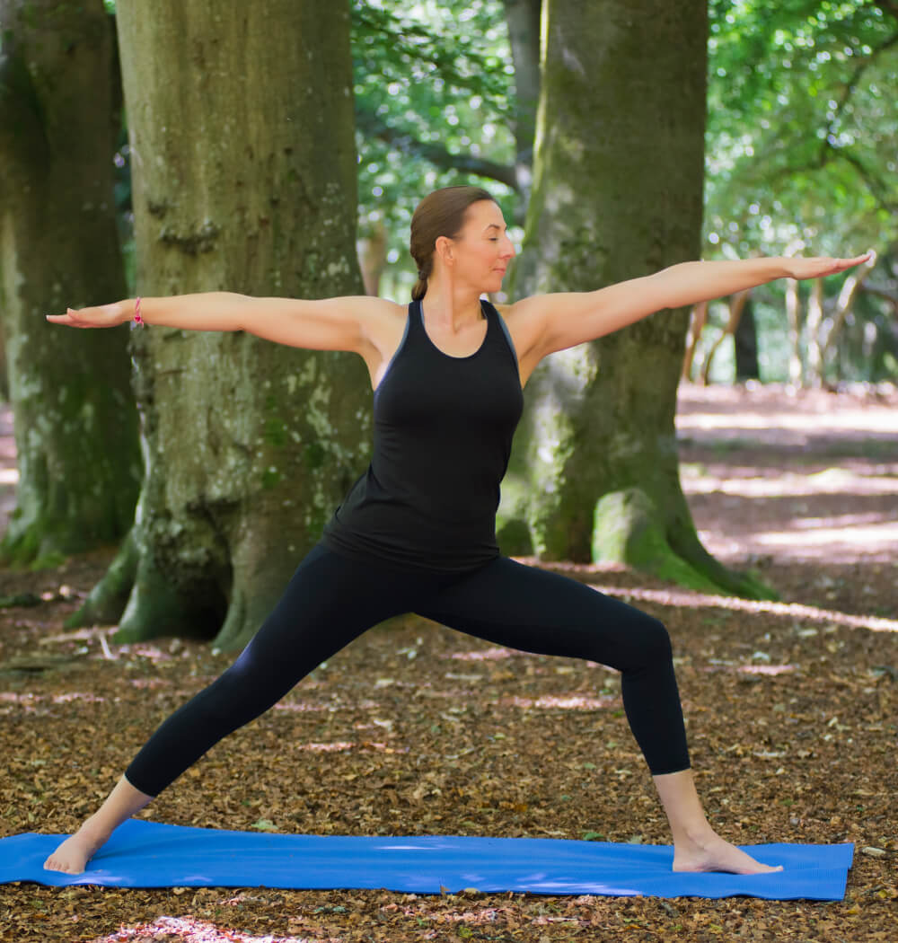 Yoga teacher Angela Keen in Warrior Two pose