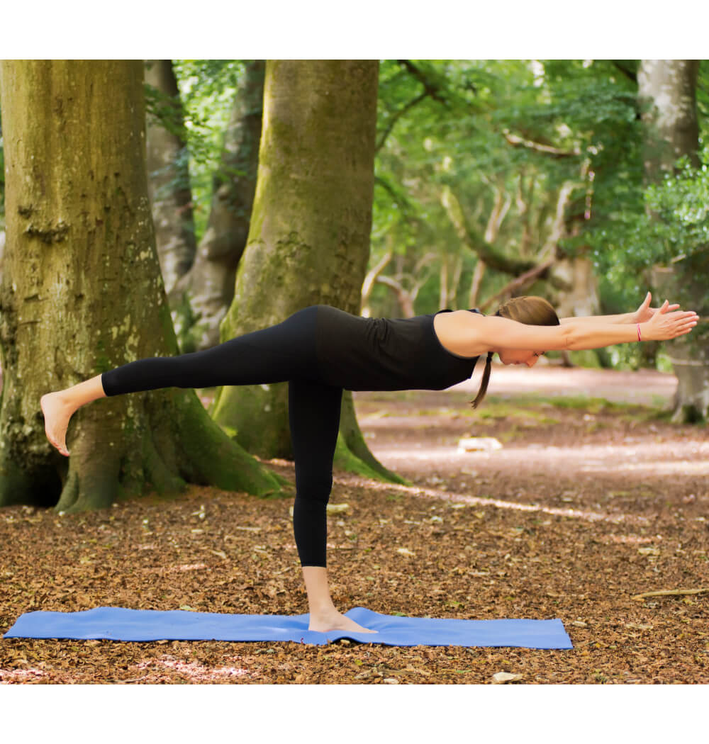 Yoga teacher Angela Keen in Warrior Three pose