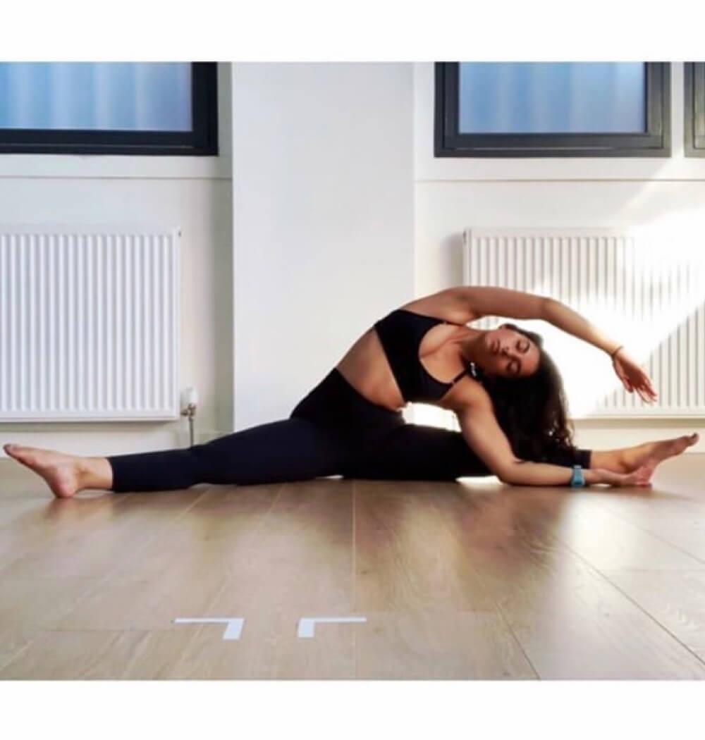 Yoga teacher Negeen Aram seated side stretch