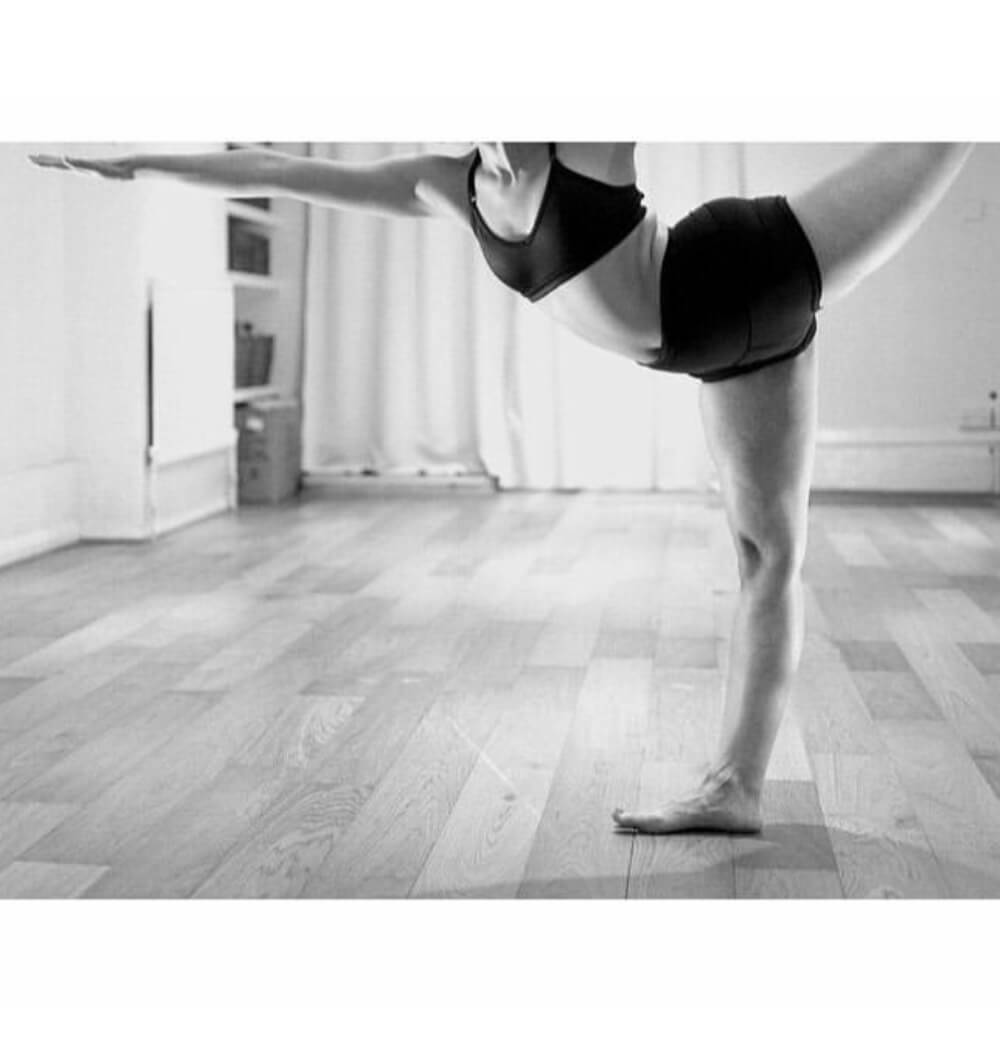 Yoga teacher Negeen Aram in dancer pose