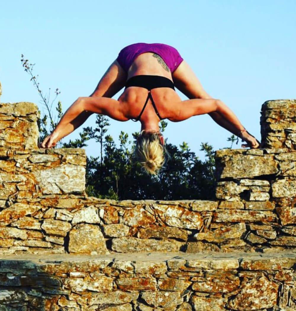 Yoga teacher Jenna Naik in Prasarita Padottanasana