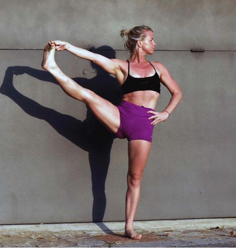 Yoga teacher Jenna Naik in Utthita Hasta Pandangusthasana