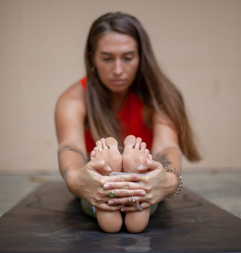 Yoga teacher Aimee Warren in Paschimottanasana