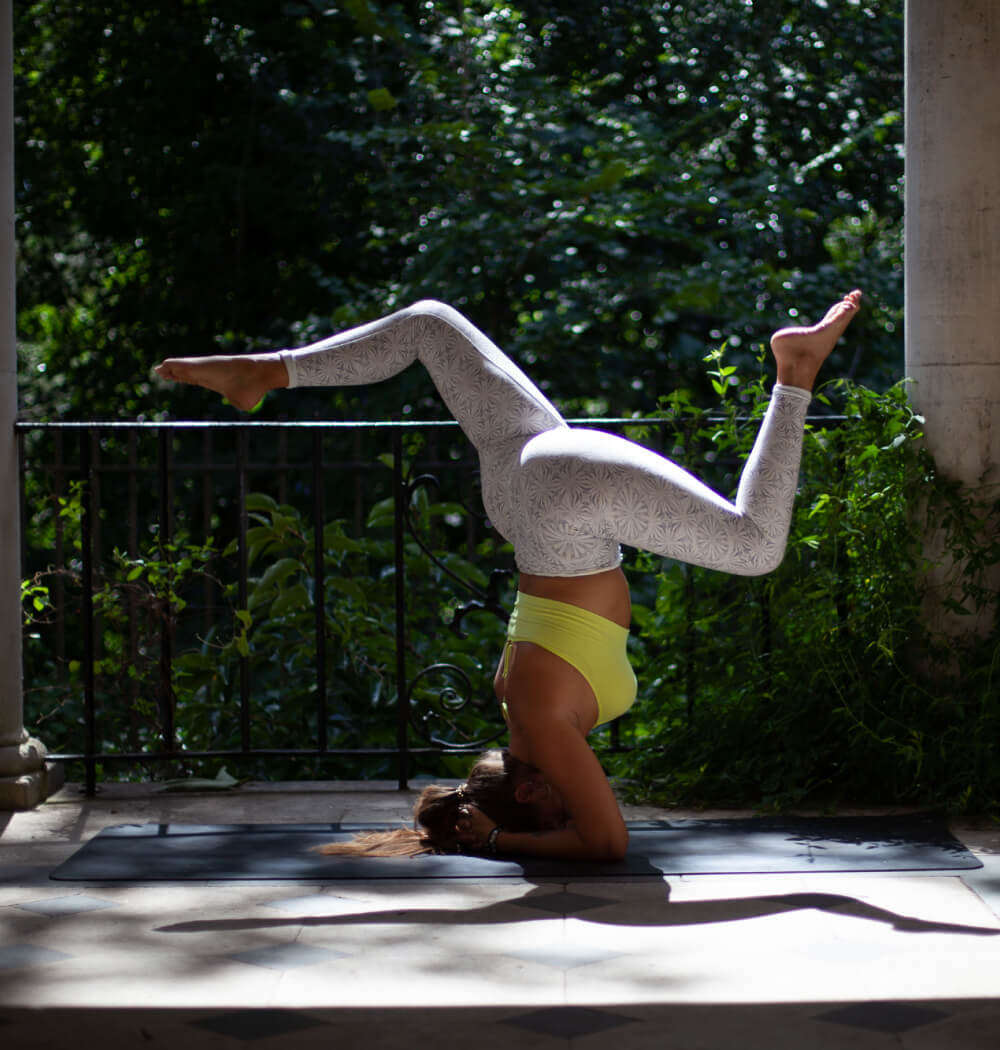 Yoga teacher Aimee Warren in headstand