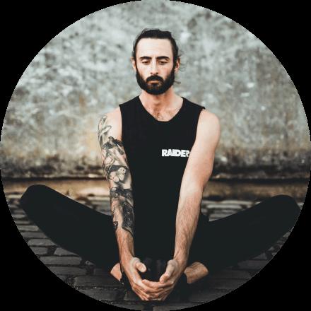 Yoga teacher Nate Thomas in Baddha Konasana