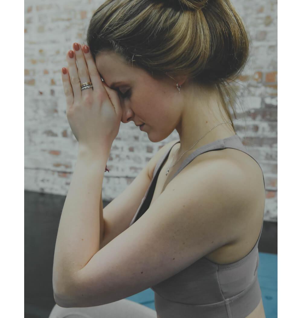 Yoga teacher Abbie Biscoe in Namaste mudra