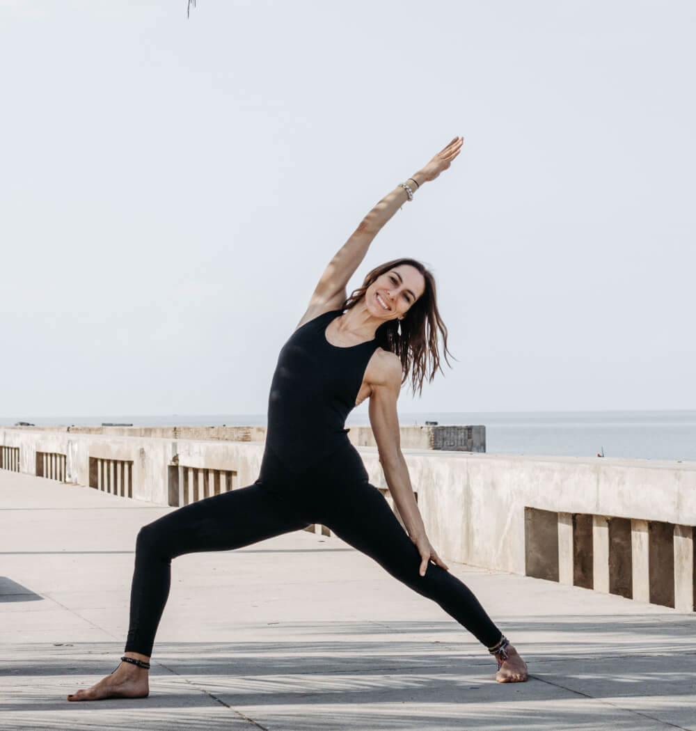 Yoga teacher Cristina Dioniso in reverse warrior pose