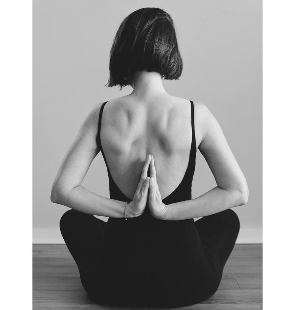 Yoga teacher Tamzen Grove in reverse Namaste mudra