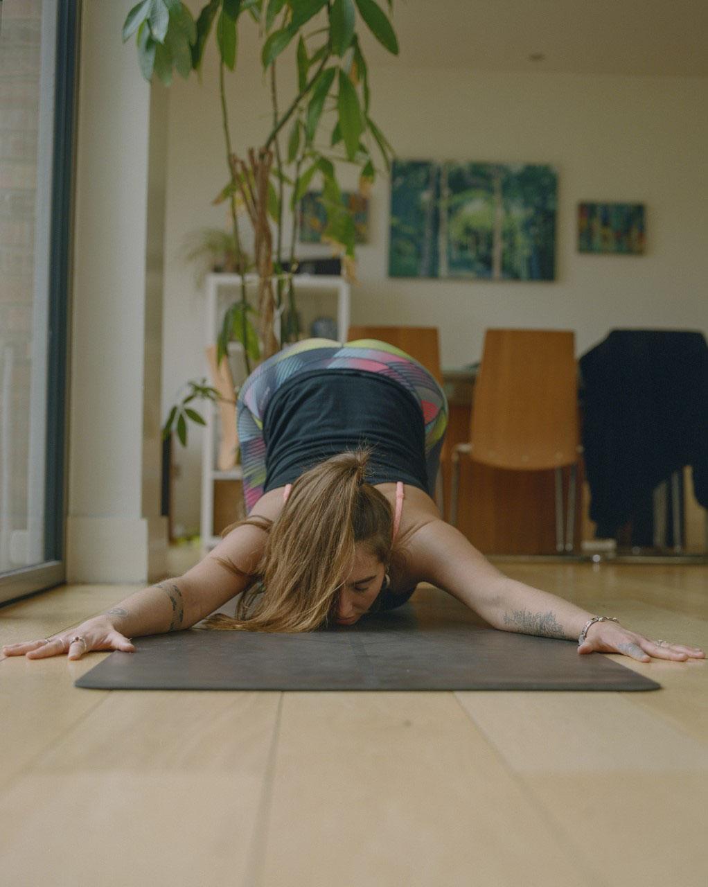 Yoga instructor Aimee Warren in puppy pose