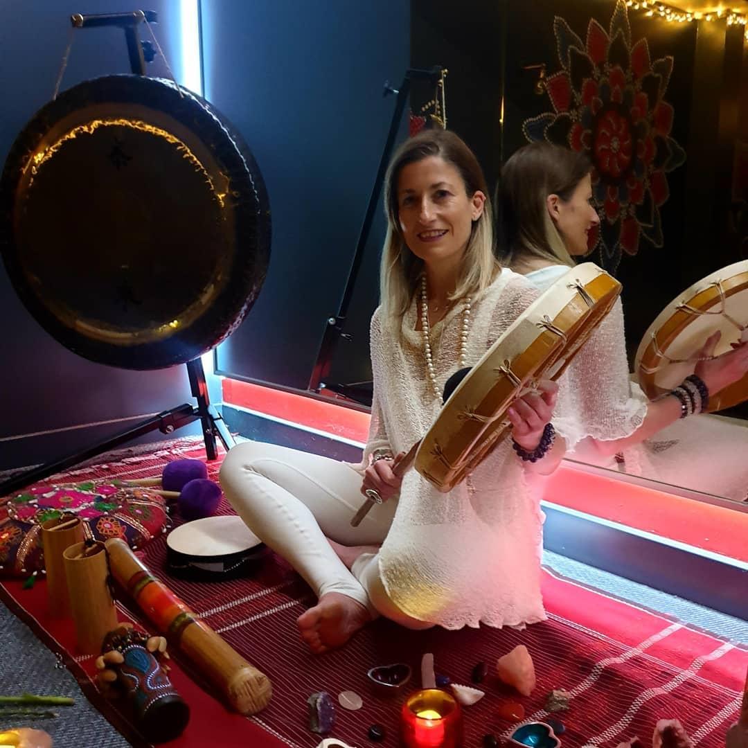 Yoga teacher Marta Antero playing Gong