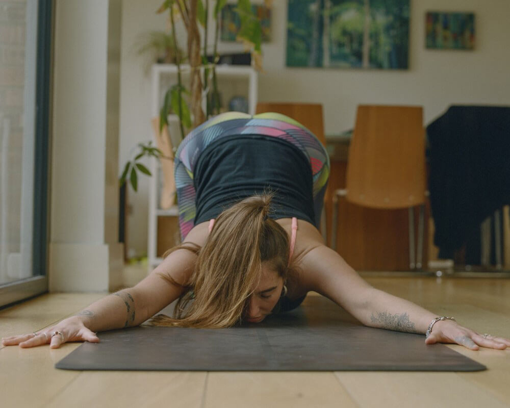 Yoga teacher Aimee Warren in puppy pose